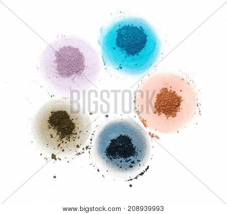 five samples of bright dry pigment in the form of a flower