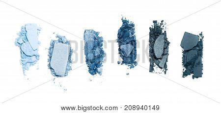 Smashed, blue toned eyeshadow make up palette isolated on white background