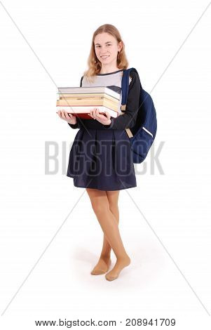 Education people teenager and school concept - teenager school girl standing with a stack book. Isolated over white