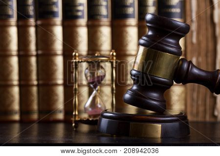 Law and justice concept - law gavel with row of books