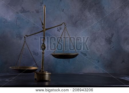 Law antique scales on dark gray background with copy space