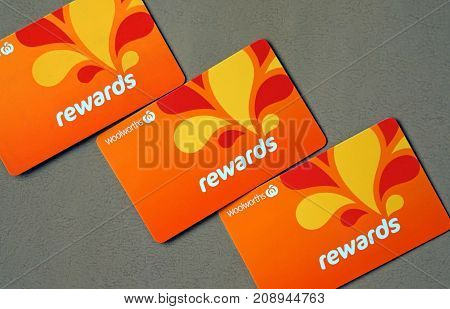 Sydney Australia - October 15 2017: Close-up of Woolworths Rewards loyalty cards. Woolworths Supermarkets is an Australian grocery store chain along with Coles together accounting for about 80% of the Australian market.
