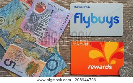 Sydney Australia - October 15 2017: Australian two major supermarket chains rewards cards and local currency. Grocery shopping savings concept.