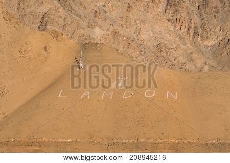 Landscape image of mountains with the word Lamdon in Ladakh India