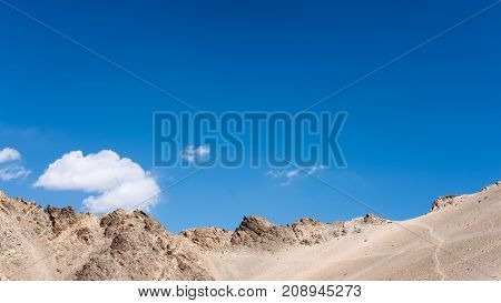 Closeup image of mountains and blue sky background in Ladakh India