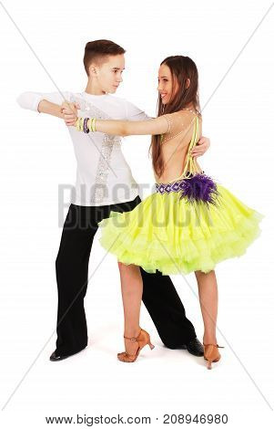 Boy and girl dancing ballroom dance on white background