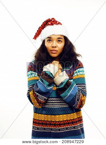 young pretty african american girl in red christmas hat isolated on white