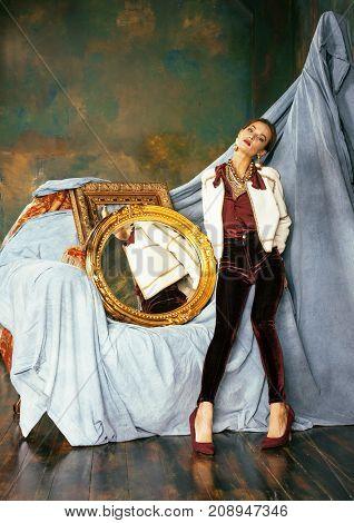 beauty rich brunette woman in luxury interior near empty frames, vintage elegance close up poster