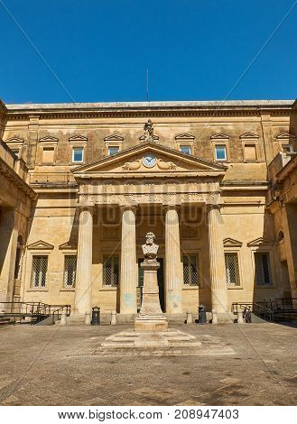 Lecce Italy - August 17 2017. Principal facade of Convitto Palmieri with the bust of Giosue Carducci in Piazzetta Carducci square of Lecce. Puglia Italy.