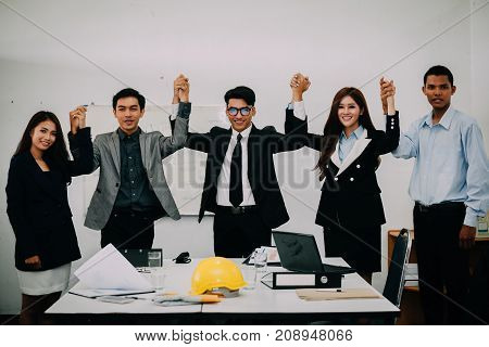 Business People Giving Five To Their Colleague After Dealing With Foreign Partners And Signing Contr