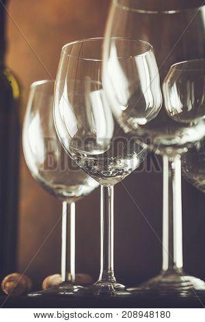 Wine. Empty wine glass. in wine cellar. Old white wine on wood.Arranged wine glasses