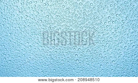 Natural water drops Background. Many Small raindrops on the glass with selective focus. Abstract Texture. Beautiful nature wallpaper.