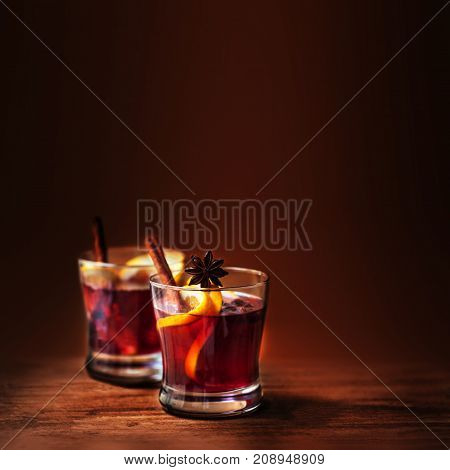 Hot Mulled Wine for winter and Christmas on wooden table with copy space. Red Hot wine
