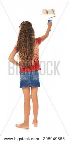 Little cute girl with paint roller on white background