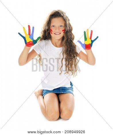 Little cute girl showing painted hands on white background
