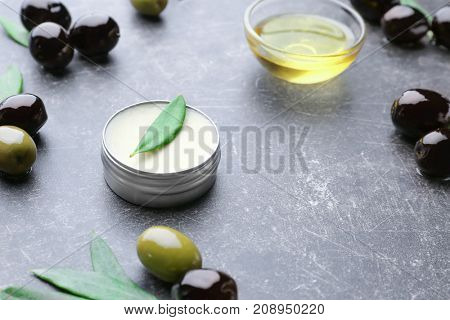 Cosmetic with olive oil extract on grunge table