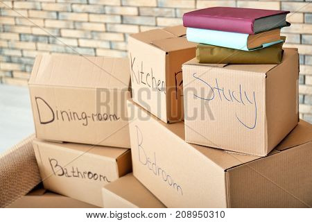 Carton boxes in room. Moving house concept
