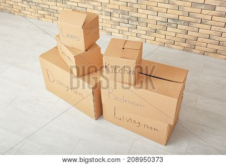 Carton boxes on floor in room. Moving house concept