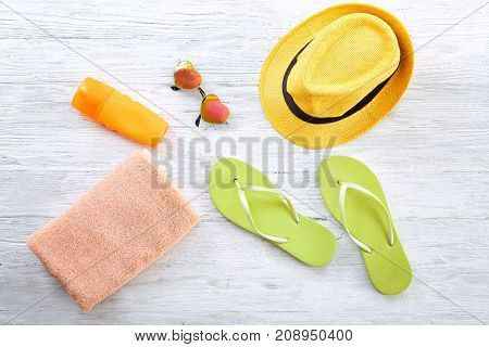 Composition with towel and summer accessories on wooden background