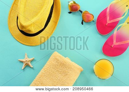 Composition with towel and summer accessories on color background