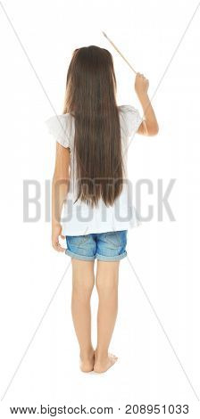 Little cute girl with brush on white background
