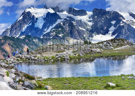 ARTIST POINT, WASHINGTON - AUGUST 19, 2017 Hikers Mount Shuksan Pool Reflection Summer Artist Point Mount Baker Highway Pacific Northwest Washington State Snow Mountain Grass Trees