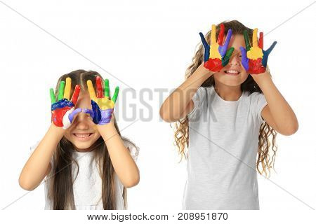 Little cute girls showing painted hands on white background