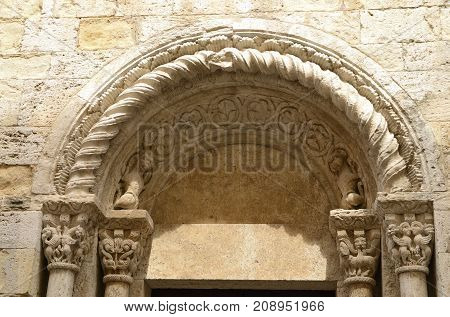 Arch of the romanic church of Saint Vicent in Besalu a medieval town of Girona Catalonia Spain.