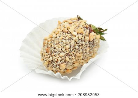 Tasty chocolate dipped strawberry covered with nuts, on white  background