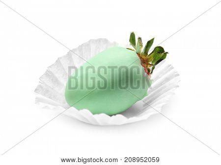 Tasty glazed strawberry on white background
