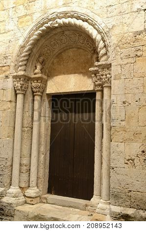 Door of the romanic church of Saint Vicent in Besalu a medieval town of Girona Catalonia Spain.