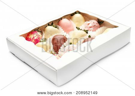 Box with tasty chocolate dipped and glazed strawberries on white  background
