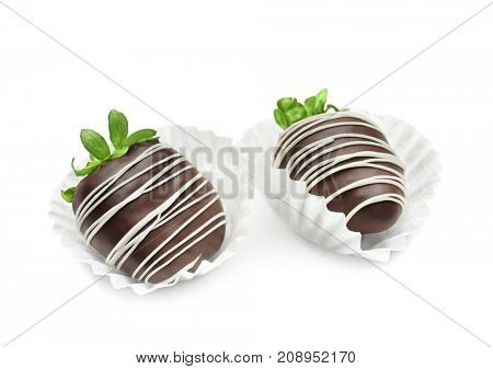 Tasty chocolate dipped strawberries on white  background