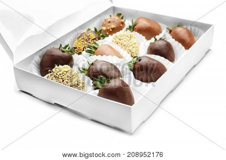 Box with tasty chocolate dipped strawberries on white background