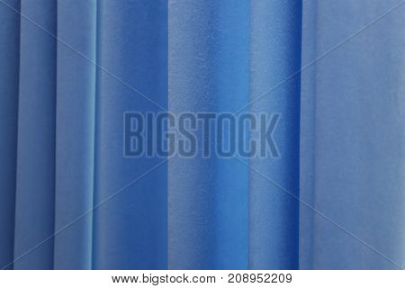 Beautiful blue curtains indoors, closeup