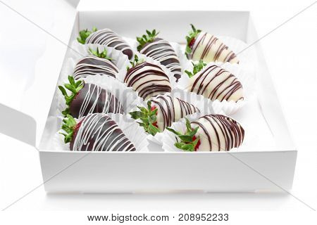 Box with tasty chocolate dipped strawberry on white  background