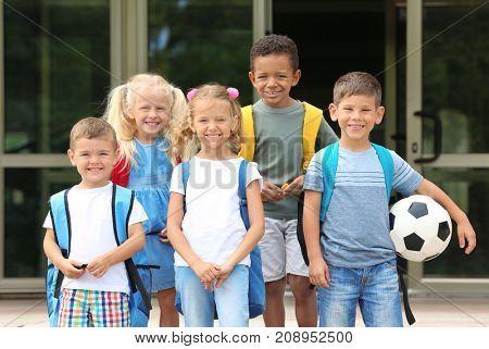 Children standing near kindergarten