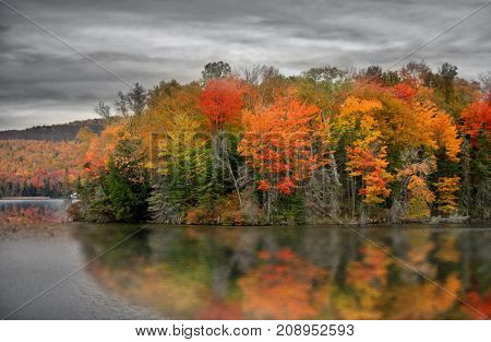 Ricker pond in Vermont with fall foliage