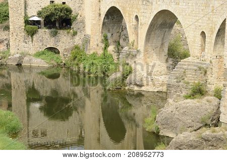 BESALU, SPAIN - JULY 26, 2017: Charmig restaurant at the bridge of Besalu a medieval town of Girona Catalonia Spain.