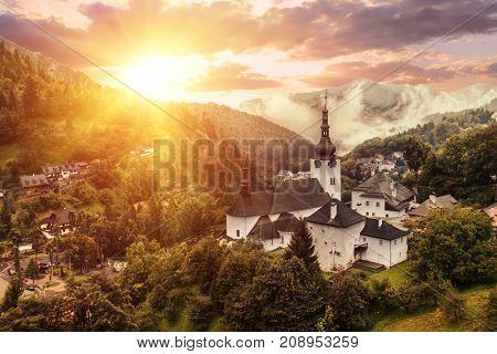 Dramatic sunset over Spania Dolina, old mining town in Slovakian mountains