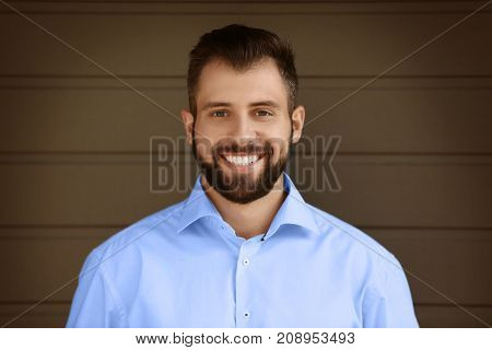 Handsome businessman on grey background