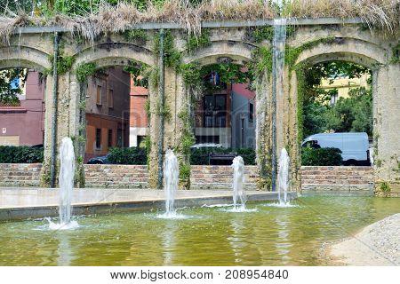 Aqueducts ancient in public park of Barcelona