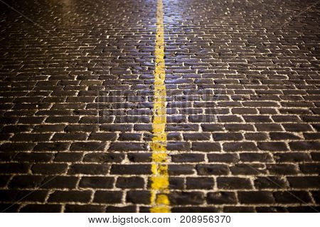 Yellow line in the city pavement (Red Square, Moscow)