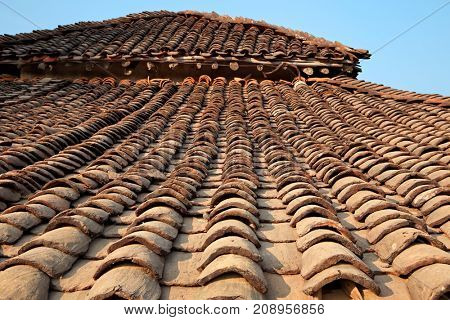 Roof of a typical Indian rural house build from rough tiles