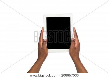 African american holding and pointing on blank screen on digital tablet. African american using device with blank screen, copy space for advertisement, isolated on white background. Point of view