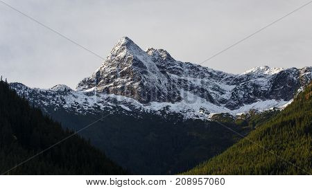 Morning view of Pyramid Peak in the Autumn Season located in the North Cascades National Park.