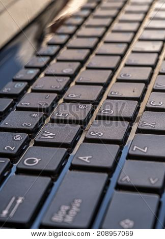 Close-up electronic of laptop keyboard with focus on button, copy space