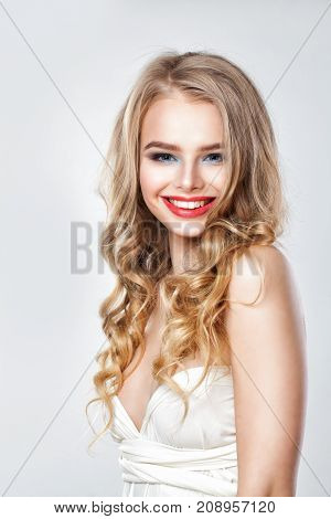 Perfect Fashion Model Woman with Blonde Permed Hair. Portrait of Cute Smiling Girl