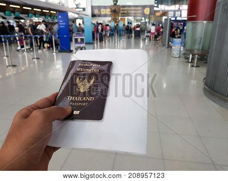 travel and business accessories concept.Passport travel concept.Passport on blurred airport background.