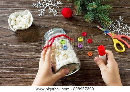 A Child Is Making A Christmas Present With A Snowman Of Sweets. Made By Own Hands. Children's Art Pr